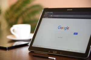With help of the laptop and Google, use SEO for small business growth.