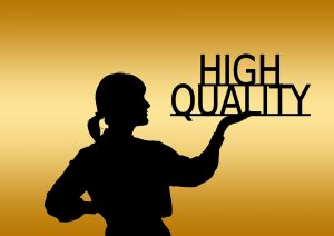 a silhouette of a woman holding the words high quality because one of the outdated SEO techniques is to offer vast number of texts with low quality